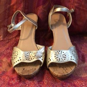 Gold wedges size 8 1/2 by Report